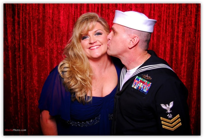 Sailor and his wife kissing in the photo booth Client Testimonials
