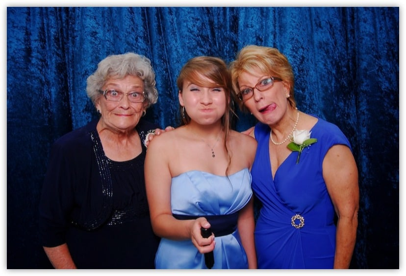 Three generations of women posing for a photo
