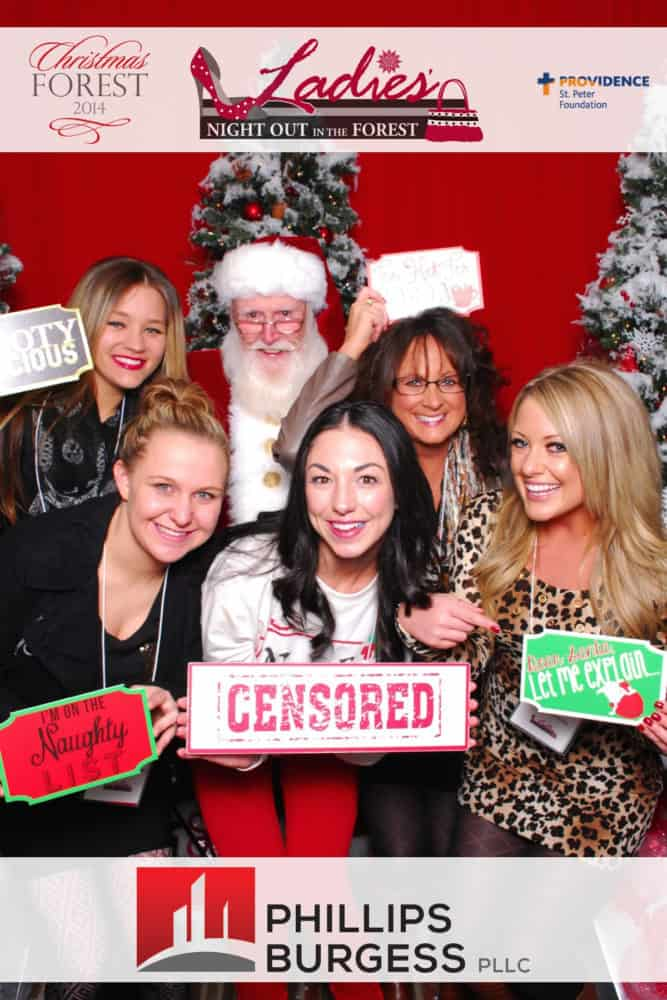 Five women posing with Santa at the Christmas Forest Ladies night out