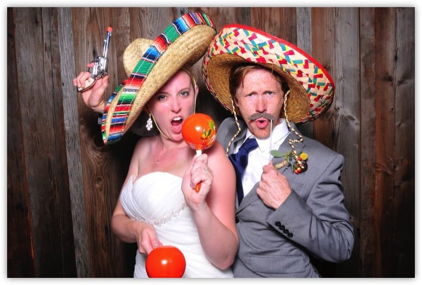 Bride and Groom with fun props