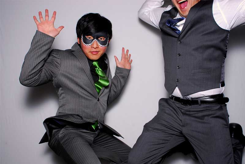 school function - Two Students Jumping in the photo at the prom