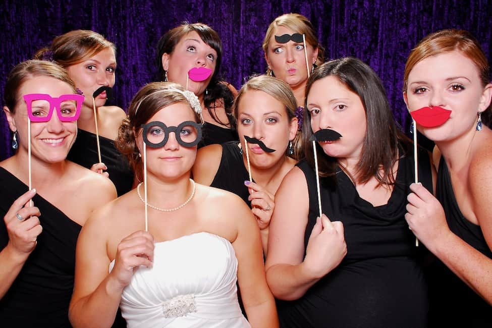 a new bride and her bridesmaids wedding photo booth