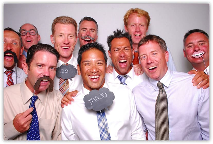 Corporate executives letting lose in the photo booth