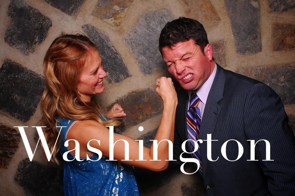 A couple striking a hit and a pose photo booth rentals Washington State