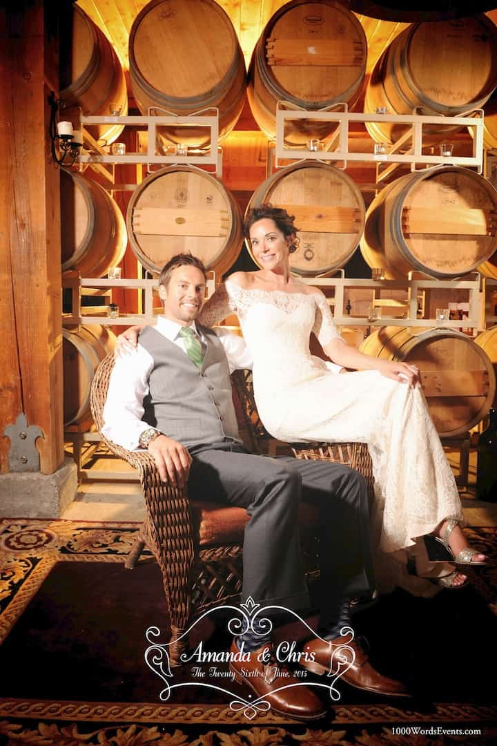 Married couple posing for a photo in the DeLille Cellars wine cellar
