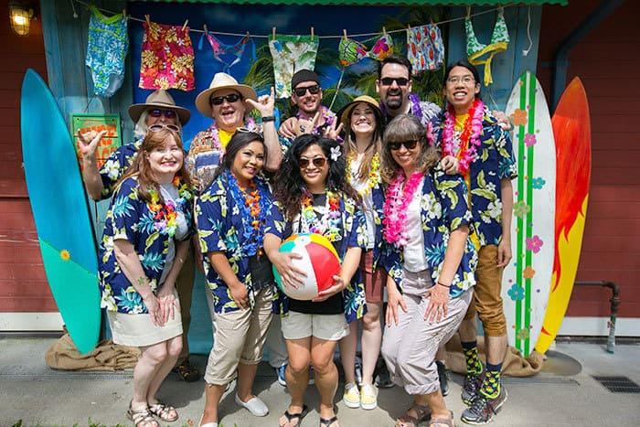 people in hawaiian shirts posing in photo booth