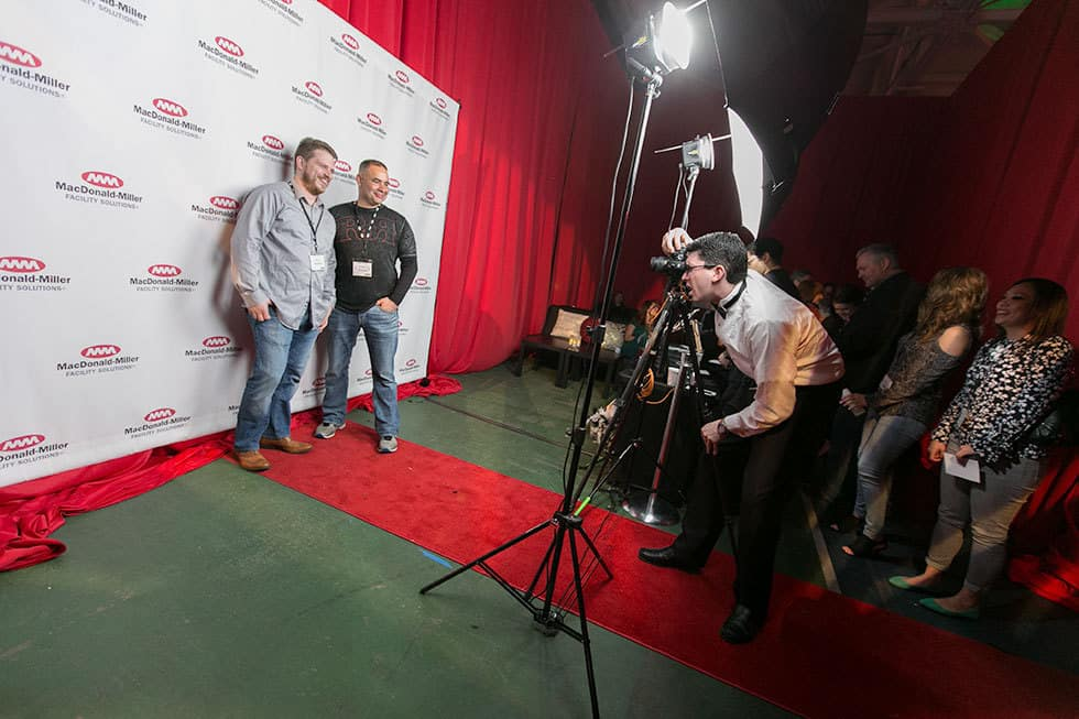 two men on a red carpet being photographed-photography services