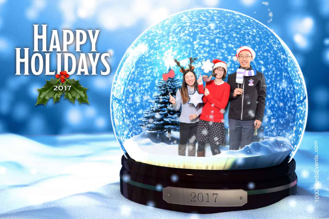 3 people in a snow globe