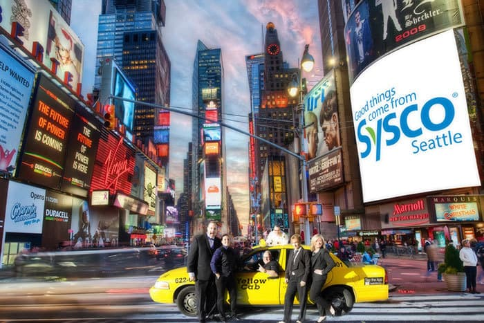 Sysco sales team in Times Square with yellow cab