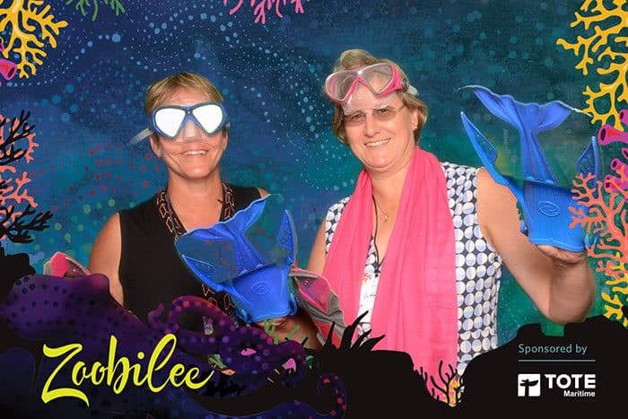 two women with snorkling gear in a green screen photo at Zoobilee in Tacoma
