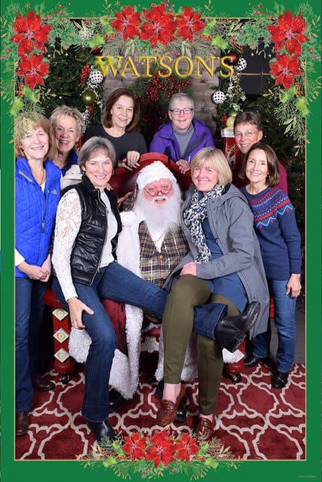 Santa at Watsons Nursery surrounded eight women