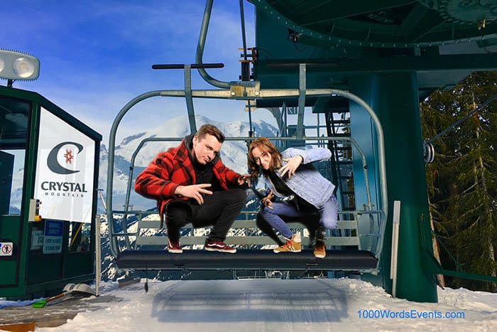 Man and women standing on a ski lift chair
