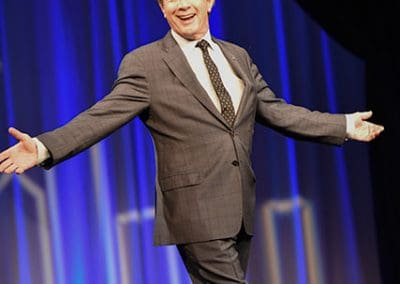 Martin Short walking on stage at a Gidas club luncheon