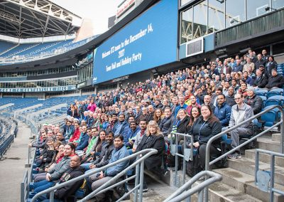 300 Alaska airlines employees posing for a group photo in Centurylink field