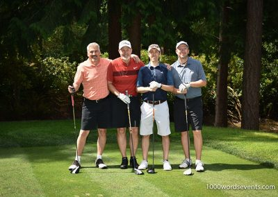 four golfers posing on a tee box at Sahallee Golf club