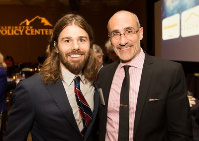 Arthur Brooks posing with Dan Price, Founder & CEO of Gravity Payments